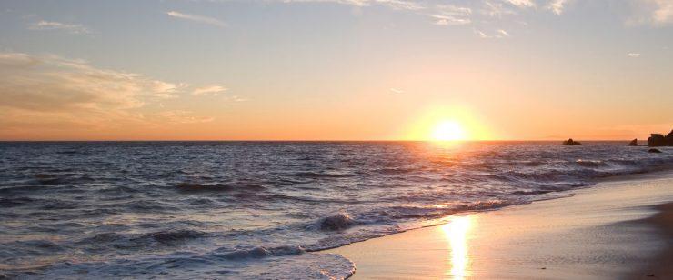 HEEL opleidingen strand zonsondergang